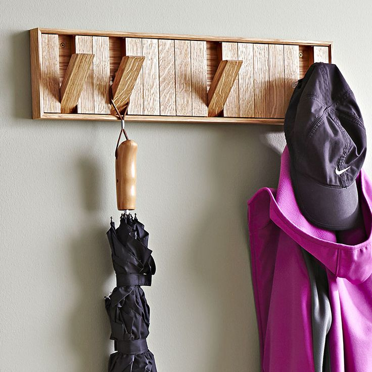 Hidden-hook coat rack woodworking plan. In just a weekend, you can whip up enough of these coat racks to organize every entry and closet in the house. Simply press the bottom end of a hook to drop it down.
