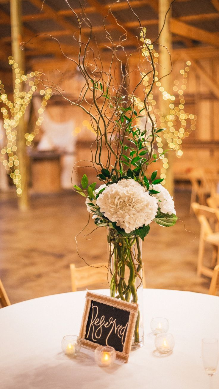 Hydrangeas and curly willow branches centerpiece  #barnweddings #reservedtables