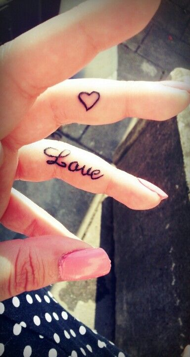 Finger tattoo heart with love