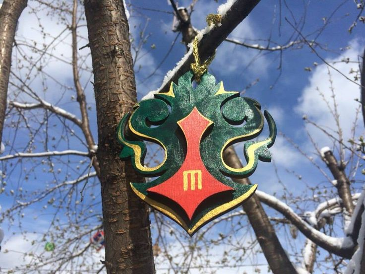 Circassian tree. A handmade coat of arms of a Circassian family hanged on a tree. #green #gold #red