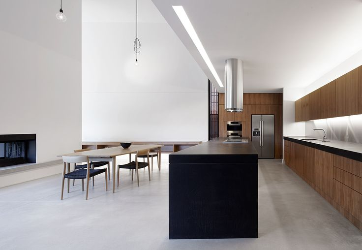 Double height and white walls addings such a strong sense of space. Interior of the  Manning Road House by Noxon Giffen.