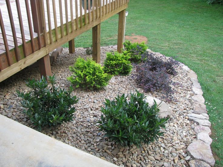 landscaping around a deck | LightsOnTheLake: Rock Garden around deck-Done!