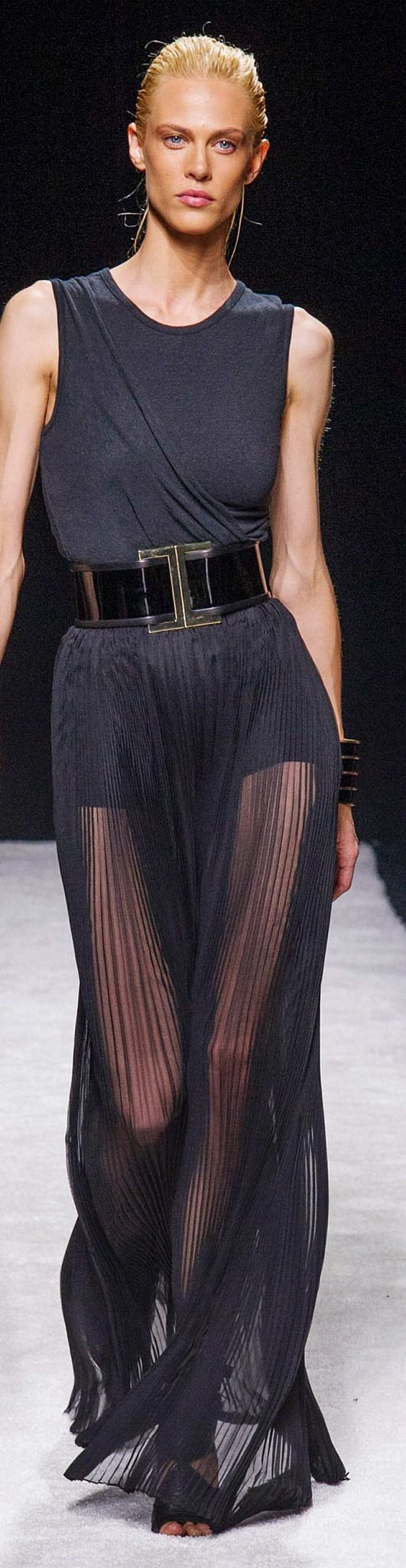 The top should either be TIGHTER or extremely draped. Being in-between the two looks sloppy.  Balmain Collection Spring 2015