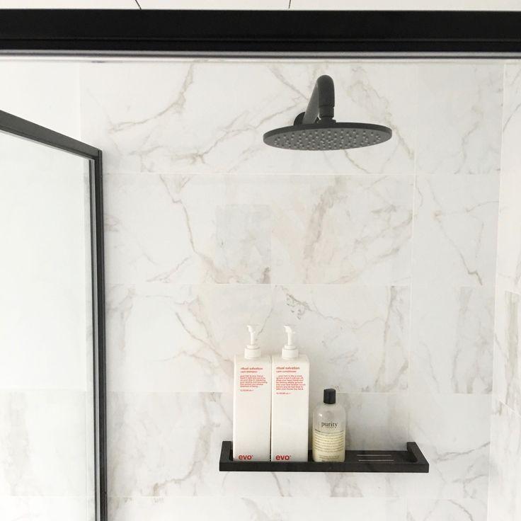matte black fittings in a carrarra tile bathroom
