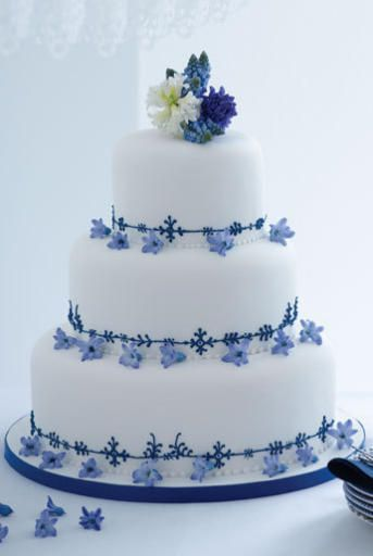 Three-tiered traditional wedding cake with blue piping,  (serves 150), Pat-a-Cake Pat-a-Cake     Photography: Dan Duchars.    For more information visit patacakepatacake.com or call 020 7485 0006.