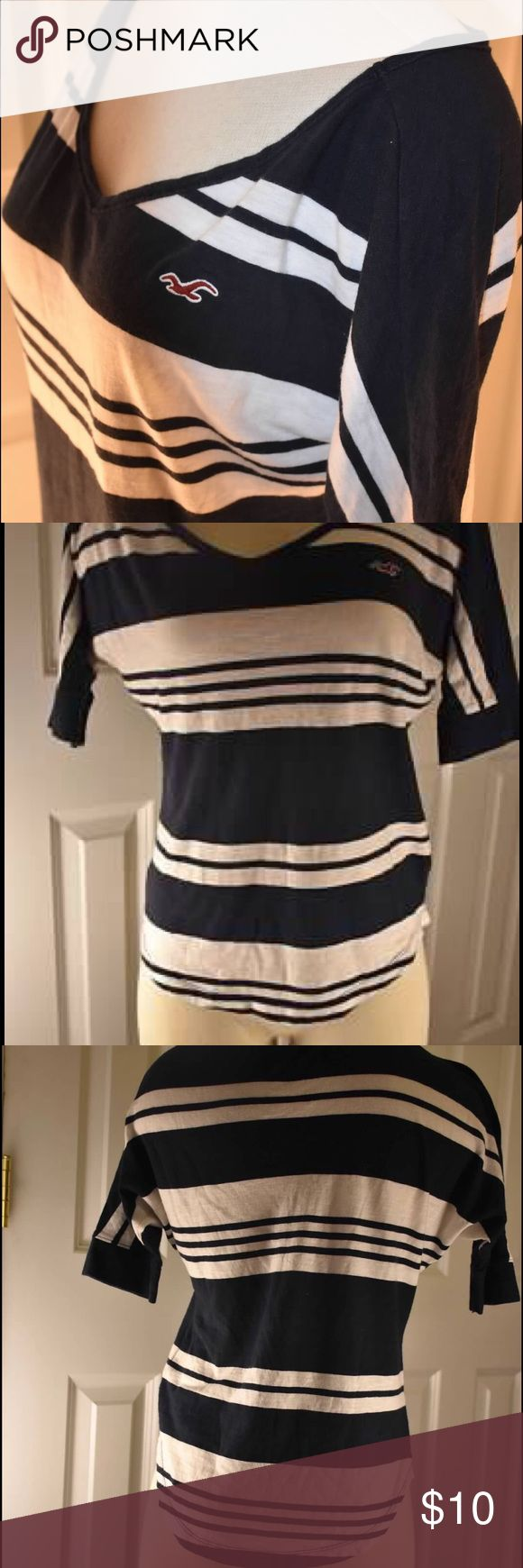 Hollister XS Navy/White stripe short sleeve top Barely worn Hollister brand XS sized short sleeved top.  Navy and white striped with high low fall bottom and longer fitted shirt sleeves Hollister Tops Tees - Short Sleeve