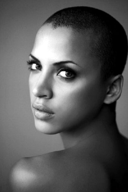 I don't have any clue who this girl is, but she is beautiful. And rockin' the bald look!