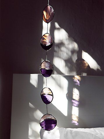 Gorgeous stained glass phases of the moon.