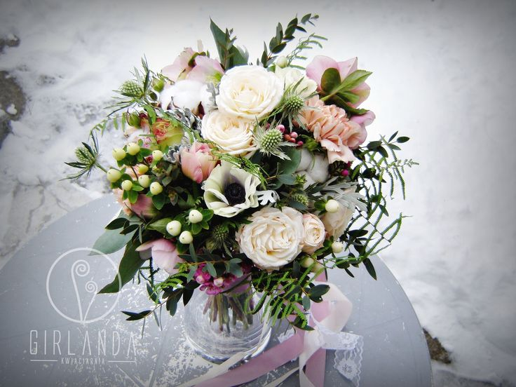 Wedding bouquet for a Bride with white, green and creamy flowers