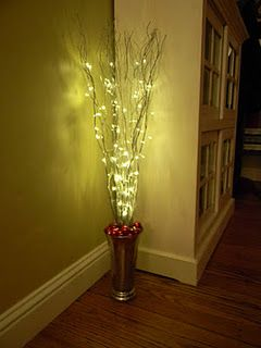 DIY Easy Christmas decoration for corners. Vase, Sticks, spray paint, ornaments, lights.