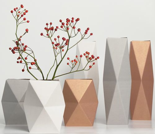 Take an ordinary material like cardboard and an old bottle or glass and what you have is a really cool geometric vase from the Germany-based snug.studio. The snug.vase is made from a piece of colored cardboard that you fold up and slip over a glass of water or bottle. Instant faceted vase!
