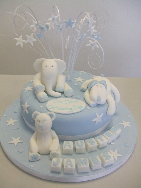 Boys christening cake with topper