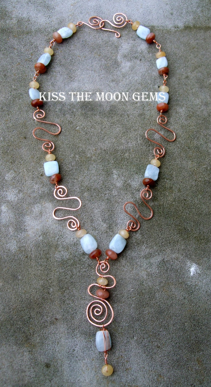 Copper swirls with aquamarine,cream quartz and red quartz. $50.00, via Etsy.