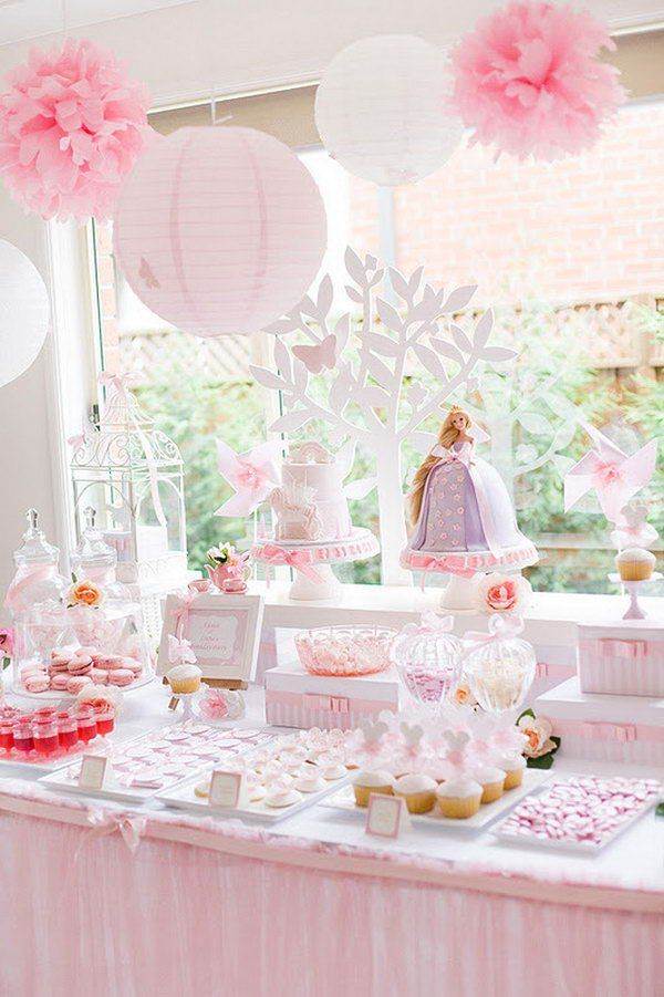 Enchanted Garden Princess Party. This dreamy garden party features its sweet stands with a series display of ribbon candies, sweet cupcakes, cookies and red drinks. The pink and white paper lantern garland decorated with tissue flowers adds up sweet and delicate touch to this party.