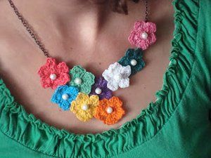 ❀ Crochet flower statement necklace. This Crochet Flower Statement Necklace is the perfect addition to almost any outfit.  These easy and fun crochet flowers can be arranged however you'd like, and this necklace is sure to spark some conversation when you wear it and show it off!