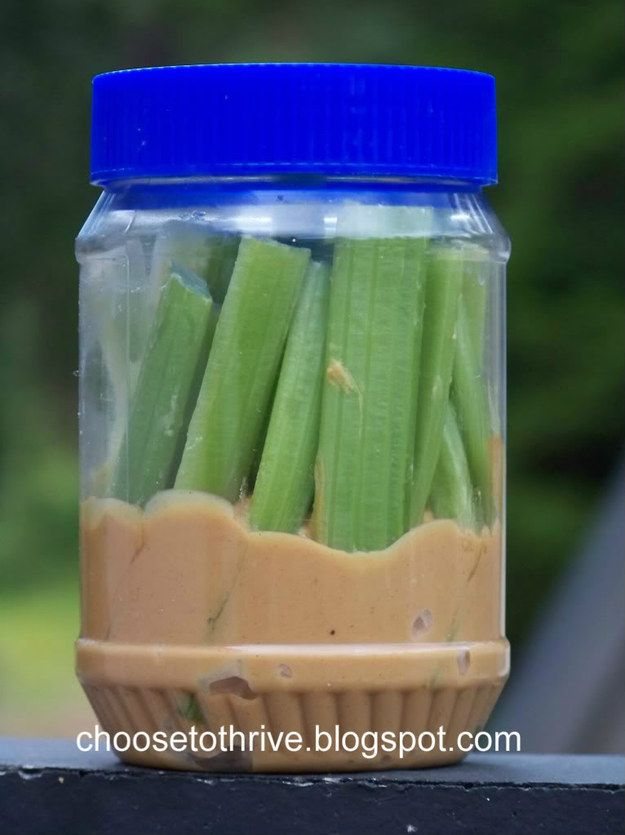 Celery sticks in an almost-empty peanut butter jar. | 19 Delicious Homemade Hiking Snacks