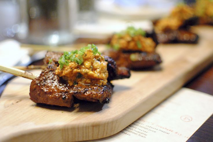 anticucho corazon beef heart, rocoto walnut sauce