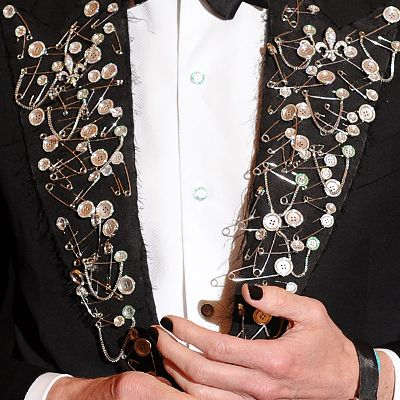 """Hamish Bowles took the """"Punk: Chaos to Couture"""" DIY message to heart, embellishing a Tom Ford tux jacket w/safety pins"""