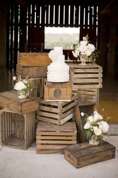 Idea for Faye's wooden crates to serve as cake table.... Or have them serve as guest photo book sign in table (stack these differently) and accent with church foyer centerpiece and burlap fabric. Could even do a few mason jars wrapped/tied with burlap, with candles inside