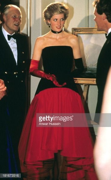 wearing a Murray Arbeid flamenco dress with one red glove and one back glove, attends the America's Cup Ball at the Grosvenor House hotel on September 01 1986 in London