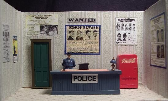 Police Office interior for O gauge building. Custom made for Ameritown buildings. Can be customized for other O scale buildings (MTH, Cornerstone, etc).  http://www.realcustomrailroads.com/storeinteriors.html