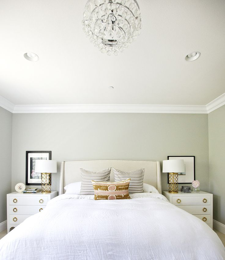 Calming green bedroom with gold accents