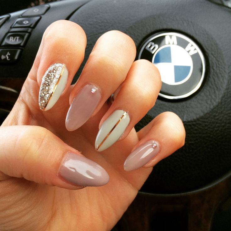 My fav so far Stiletto style gel extensions in beige and off white white rose gold lines and Swarovski gems nudes. Gel. Nail art.