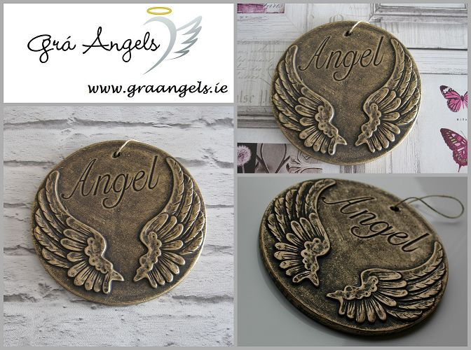 This is a fab Angel wing wall hanging plaque that would make a great addition to any home or garden. The plaques are available in both silver and gold. This is available for €9.99 on our website here http://graangels.ie/angel-hanging-plaque-(dark-gold-colour)  These plaques are hung on the wall using the provided string loop. It is approximately 19cm tall.