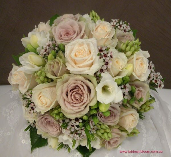 BG44 Cream `Vendella` roses, mushroom `Creme de Menthe` roses, Geraldton wax, chincherinchee, white freesias
