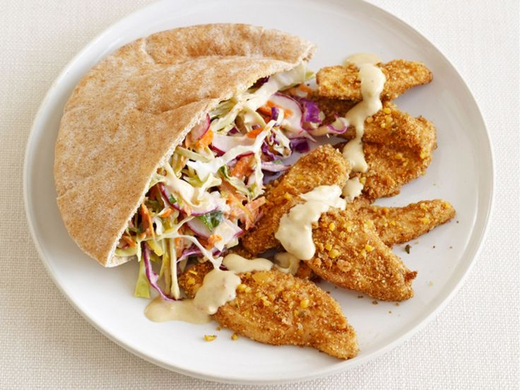 Falafel-Crusted Chicken with Hummus Slaw : Store-bought falafel mix gives baked chicken a great crispy crust and pairs perfectly with spicy harissa hummus.