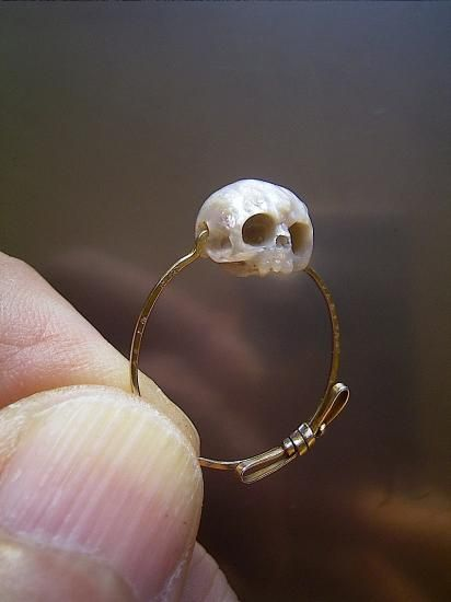 carved pearl skull ring