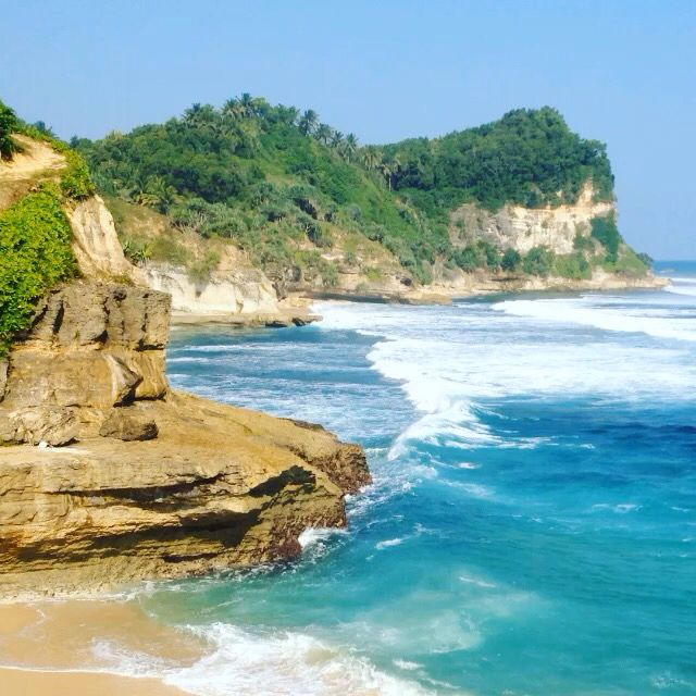 Banyu Tiba beach, literally means 'water fall', is located at Pacitan, East Java. It is characterized by Karst wall cliff and even more beautiful with its water fall sent by a small river to meet the ocean.