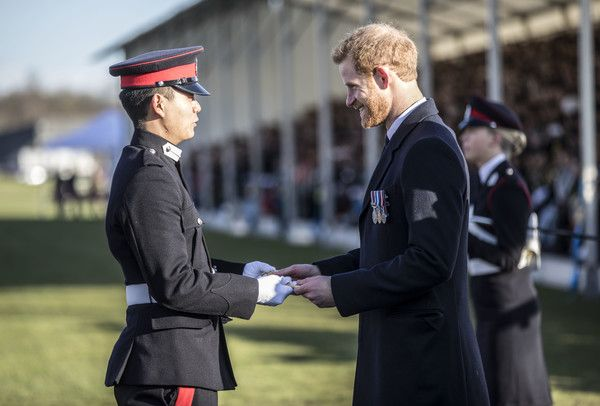 Prince Harry Photos - Prince Harry presents the International award to officer cadet Tang Mindong from the people's republic of China during the Sovereign's parade at the Royal Military Academy Sandhurst on December 15, 2017 in Camberley, England. - Prince Harry Attends the Sovereign's Parade