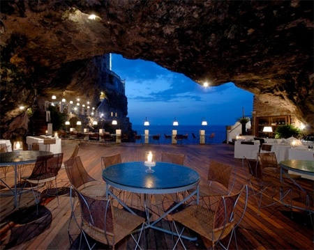Cave restaurant is located underneath the Grotta Palazzese hotel in a small town of Polignano a Mare, Italy. The customers can eat delicious Italian food and look at the sea. niksy