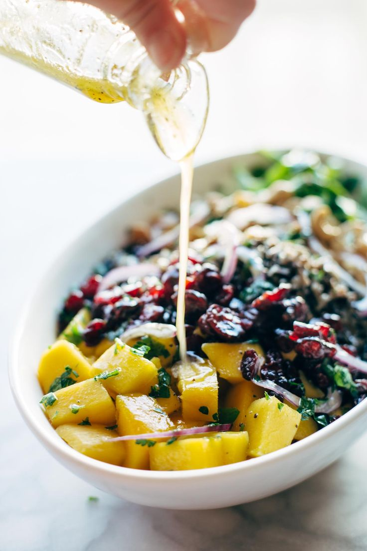Easy Thanksgiving Salad - arugula, cashews, dried cranberries, red onions, wild rice, and a lemon dressing that shakes up easily in a jar. This recipe is ALWAYS a hit for Thanksgiving! also: conveniently gluten free and vegan. | pinchofyum.com