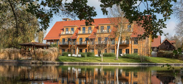 Outside view of the sustainable hotel Strandhaus Spreewald in Germany.