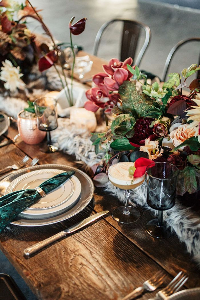Copper and Jewel Tone Botanical Tablescape https://heyweddinglady.com/industrial-chic-warehouse-wedding-modern-edge/    #wedding #weddings #weddingideas #industrial #modernwedding #lawedding #centerpiece #floralarrangements #weddingflowers #floraldesign #placesetting #velvet
