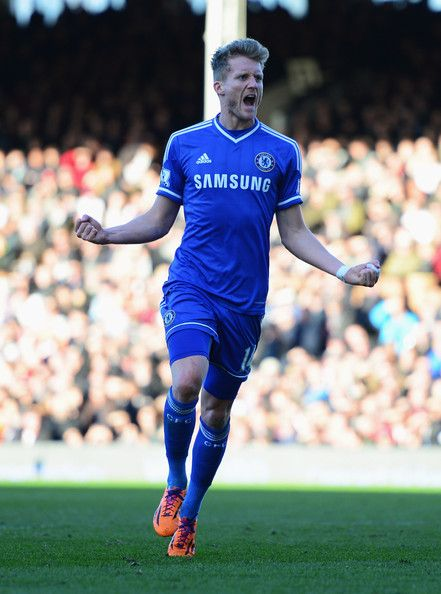 Andre Schurrle of Chelsea celebrates as he scores their first goal during the Barclays Premier League match between Fulham and Chelsea at Cr...