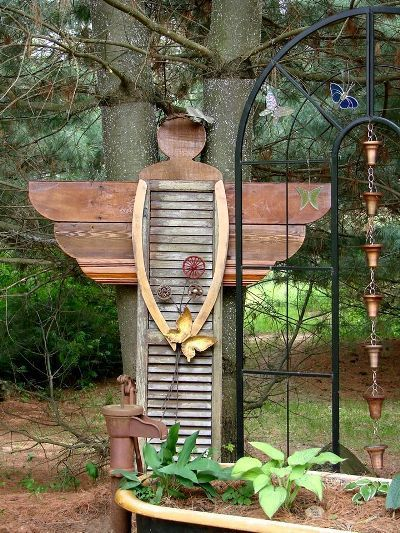 DIY Garden Angel made from old shutter. Creative ways to add color and joy to a garden, porch, or yard with DIY Yard Art and Garden Ideas! Repurposed ideas for the backyard. Fun ideas for flower gardens made from logs, bikes, toys, tires and other old junk. ~ featured at LivingLocurto.com