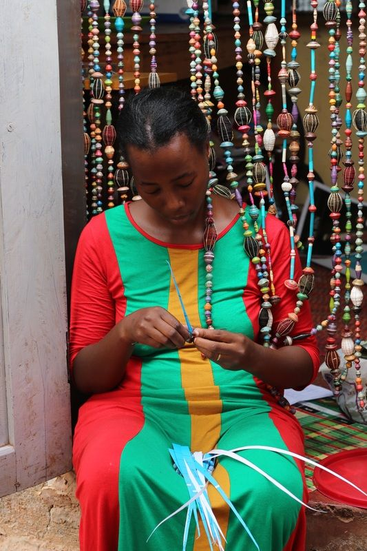 Polyne busy creating beads for Mzuribeads Uganda from her home near to Kampala