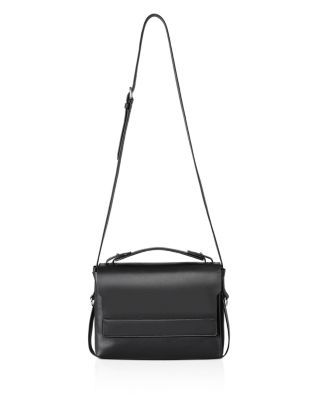 Coolly refined, Allsaints' work-or-weekend shoulder bag is crafted of supple, ethically sourced calf leather. | Cow leather | Imported | Top handle, adjustable shoulder strap | Magnetic closure; unlin