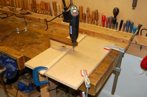 Dremel Router Table by Christopher Martyn -- Homemade Dremel router table constructed from MDF and wood. http://www.homemadetools.net/homemade-dremel-router-table-2
