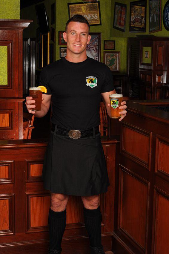 Tilted Kilt Guy Bartender holding a Blue Moon and a crisp, cold IPA.