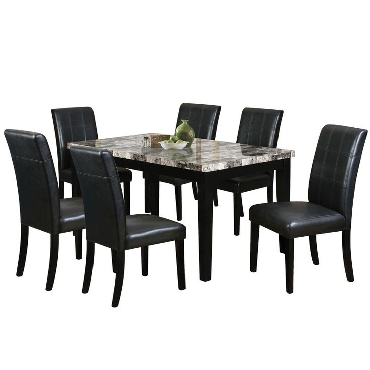the wilcox 7 piece dining set has a modern design with a black finish on hardwood accented by natural tones features 1 rectangular table with