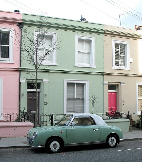 Nissan Figaro. I want one, preferably in this color, or in red. (And judging by the houses this could easily be the one I see around Cheltenham nearly every day!)
