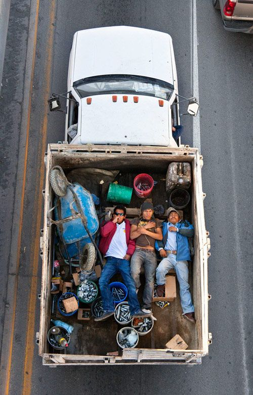 """""""Men Riding in Trucks"""" by Alejandro Cartagena. This is a series of photographs from a Mexican overpass of men riding in the back of trucks."""