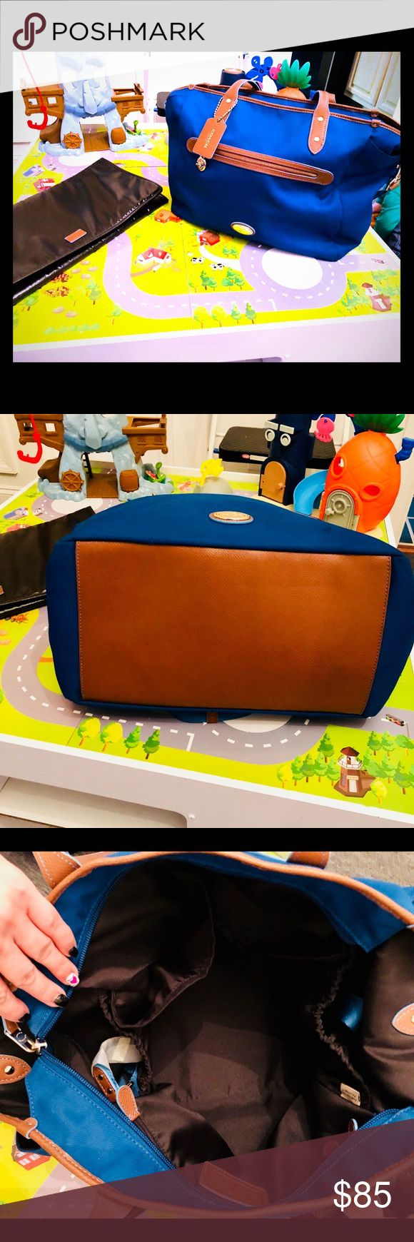 Coach Diaper Bag w/diaper pad Super cute Coach Diaper Bag w/ diaper Pad in excellent condition inside and out. Note: there is a small marker stain by zipper see photos but does not take away from bag or function. Perfect for a girl or boy. Coach Accessories Bags