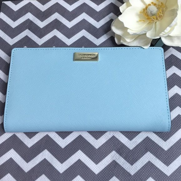 """Katr Spade Wallet Gorgeous authentic Kate Spade wallet in blue hydrangea. 12 credit card slots, one ID slot, and 2 billfold. 14k light gold plated hardware. 3.5""""h x 6.6""""w x 0.5""""d. Bundle to save more! NWT. All negotiations should be made through the offer button. No trades please. kate spade Bags Wallets"""
