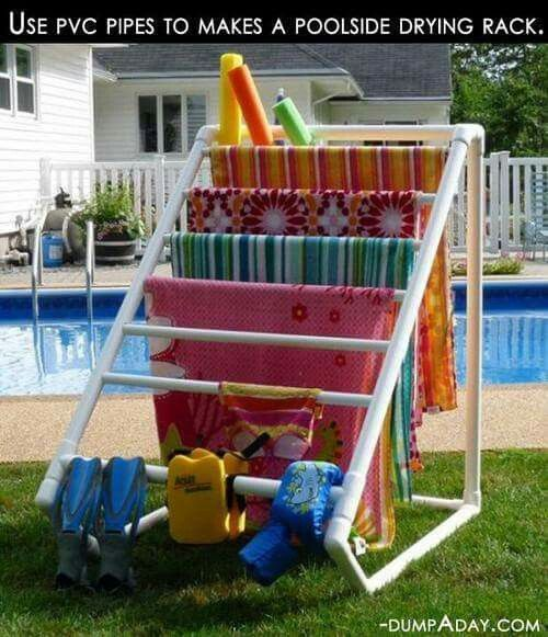 Pool side drying rack made of PVC pipe.