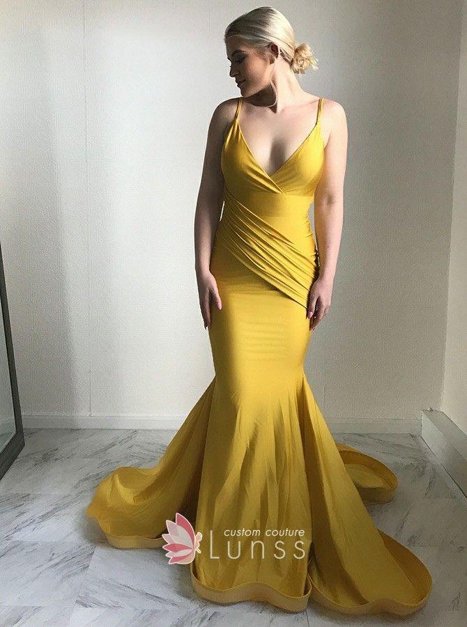 b32d526e9b Asymmetrical draped gold jersey mermaid long prom dress. Deep V neckline  with spaghetti straps. Flounced court train.